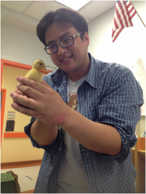 Mr. Andy holding a duckling